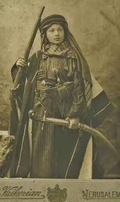 A youth in Arab dress. Jerusalem, Palestine, late-Ottoman era, ca. 1900.