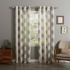 You'll love the light, airy appeal of these linen and polyester blend curtains. In delicate neutral colors, these medallion printed drapes offer up a serene vibe, complete with grommet top.