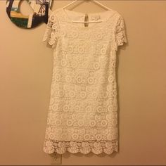 White lace, knee length dress. White lace dress, shift style, lined on the inside. Anthropologie Dresses