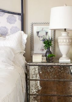 """Julie Couch Interiors - """"House Envy"""" The antiqued mirrored side tables feel glamourous and are unexpected with the more casual fabrics. Small pieces of art above bedside tables make bedrooms feel more intimate and bring the scale down in larger spaces."""