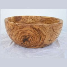 olive wood..... someone got a gorgeous bowl! it sold, but would love to keep looking for one of my own.....