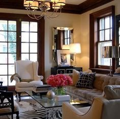 modern romantic design in a room with dark wood trim and molding