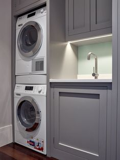 A washing machine and tumble dryer are stacked in this grey handleless Shaker utility, painted in Farrow and Ball Worsted and combined with a white Silestone Blanco Zeus quartz composite worktop. Boot Room Utility, Small Utility Room, Utility Room Storage, Utility Room Designs, Small Laundry Rooms, Laundry In Bathroom, Small Downstairs Toilet, Small Toilet Room, Laundry Room Layouts