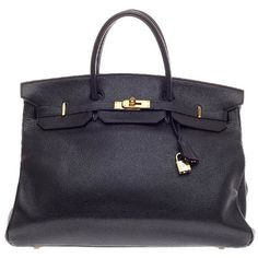 Pre-owned Hermes Birkin Black Buffalo with Gold Hardware 40 ($10,560) ❤ liked on Polyvore featuring bags, handbags, tote bags, handbags and purses, totes, oversized leather tote, black studded tote, leather purse, black leather tote and black leather tote bag