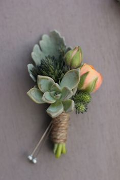The rest of the boutonnieres will be orange ranunculus, gray succulent, and pink heather wrapped in gray ribbon and the stems showing.