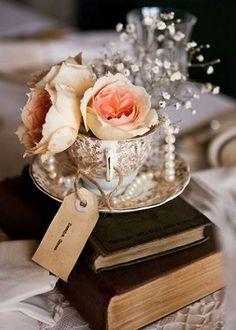 vintage china teacups and pearls wedding centerpiece / http://www.deerpearlflowers.com/vintage-pearl-wedding-ideas/