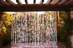 Ombre #wedding flower petal curtain.   ©Jane Z Photography  http://stylesizzle.com/bridal/wedding-week-community-florist