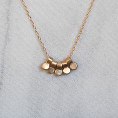Gold Dewdrop Necklace - Five Tiny 14k Gold Pendants - Eco-Friendly Recycled Gold by LilianGinebra on Etsy https://www.etsy.com/listing/217493439/gold-dewdrop-necklace-five-tiny-14k-gold