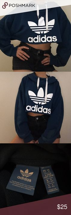 cutest blue adidas cropped hoodie comfy and great condition besides discoloration on left sleeve (last pic)  marked as size medium (third pic)  modeled on size small  raw hem  #adidas #cropped #croptop #swap #trade #cheap #sale #sweater #hoodie adidas Tops Sweatshirts & Hoodies
