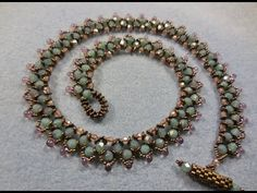 Seed bead jewelry Moon Rocks Necklace ~ Seed Bead Tutorials Discovred by : Linda Linebaugh Spring Flower Buds Necklace Part These are the Milky Turquoise Pink Topaz… Try this for Garden Plaza classes Pony Bead Jewelry, Bead Jewellery, Pony Beads, Clay Jewelry, Rock Necklace, Seed Bead Necklace, Pearl Necklace, Beaded Necklace Patterns, Beaded Bracelets