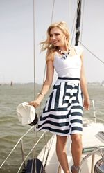 Spring and summer call for sailor stripes, and the Lost At Sea skirt delivers a darling dose.  A row of crisp white buttons drops from the high, fitted waistline of this bold blue-and-white number to just below the knee with a hint of flare for a flouncy summer shape. The skirt if finished with roomy pockets perfect for keeping your shoreline finds of seashells and sea glass tucked safely away.  Doll it up with a daring scoop neck cami and pearls, or pull a comfy lightweight sweater over it