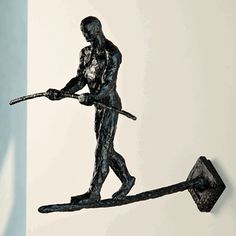 Finding Balance wall mounted iron functional sculpture