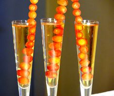 Grapes and Champagne Recipe - In Spain, revelers eat twelve grapes at midnight on New Year's Eve: the sweetness of each grape indicates the quality of each month ahead. Incorporate this tradition into your celebration by threading grapes onto skewers and placing them in a glass of bubbly.