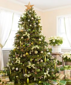 Trimmed in shimmering greens (chartreuse, celadon) and metallics (silver, gold), a twinkling Tannenbaum truly captures the limelight. Pale poinsettias in quiet containers enhance but don't upstage the palette.   - GoodHousekeeping.com