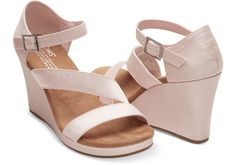Looking to wear a strappy wedge on your wedding day? Meet The Clarissa. With a grosgrain wrapped wedge and an open toe design, this shoe is sure to be a favorite long after the dress is stored away.