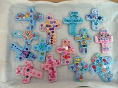 Salt water dough cross (4 part flour, 1 part salt, 2+ part warm water) with beads pushed in. Bake for 2 to 3 hours at 250-300 degrees until hard, but not burned. Cool, then cover in Mod Podge to keep loose beads from falling off.