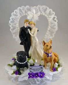 Customized bride and groom with female black pug and male golden retriever mix wedding cake topper. Personalized blonde / light brown hair. Shown in white with purple accents and optional heart backdrop. Includes name and wedding date plate. http://www.affectionately-yours.com/yours-mine-and-ours-wedding-cake-topper/