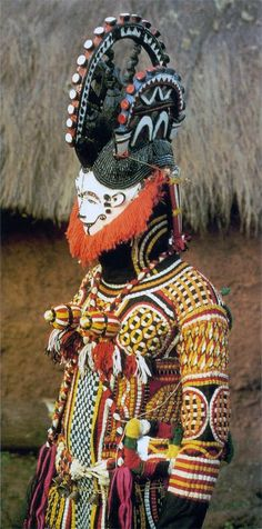 "Africa | ""Maiden spirit"" masquerade. Oka, Alaigbo.  Nigeria. ca. 1930s | ©G. I. Jones."