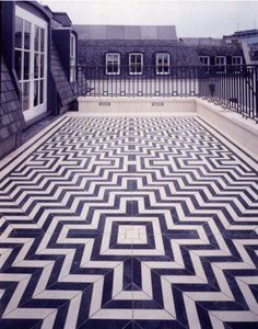 Black and white tile patterned floor on rooftop balcony (vie Rue Magazine's FB page)