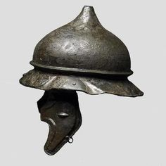 """Middle 1st c. B.C. Celtic - Gaul Iron  Age helmet.  (discovered: Forêt de Rouvrey, Normandy). """"These famous types of helmet worn by Gallic warriors around the time of Caesar's war in Gaul in the 1st Century BC. These helmets come from Agen and Alesia in France""""-http://www.twcenter.net/forums/showthread.php?618988-Celtic-Helmet-Types-A-Guide"""