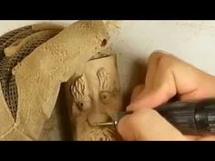 Jordan Straker uses a Dremel rotary tool with a variety of attachments to add detailing to a carving of a knapsack. I'm using one of the rough carbide bits t...