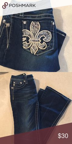 Miss Me Jeans Great deal on Miss Me jeans. They are boot cut and dark denim. I can't wear them anymore so it's a great advantage for you. Buckle Bottoms Jeans