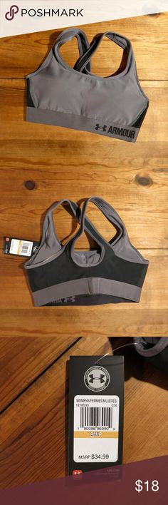 Under Armour Women's Armour Mid Sports Bra NWT Under Armour Women's Armour Mid Sports Bra helps you stay fit and focused. Lightweight HeatGear® fabric keeps you cool, while a compression fit and four-way stretch build grant unrestricted movement. Moisture-wicking properties eliminate sweat, the athletic racerback design maximizes breathability, and a soft elastic band creates a secure fit. Built for medium-impact activities, the UA Mid Sports Bra offers unparalleled performance. No returns…