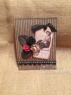 I created this matchbook album using Graphic 45 Coumminque Collection.  Inside folds out with individual squares for some of your favorite pictures.  #graphic45 #communique #matchbookalbum