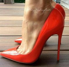 Red patent pumps and toe cleavage