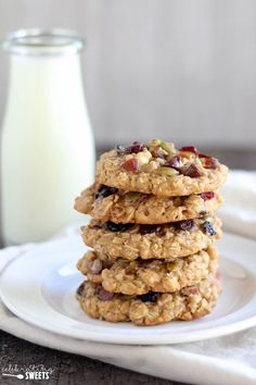 Stack of 5 oatmeal cookies with a glass of milk in the background.