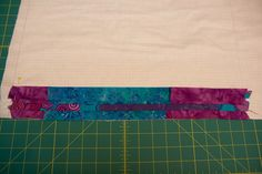 Press open your strips. Then cut another strip from the bottom of panel 2 and layer it face down on top of the previous strip you sewed. Sew the next strip in place.