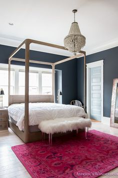 The wall paint color is Inkwell SW 6992 by Sherwin Williams.