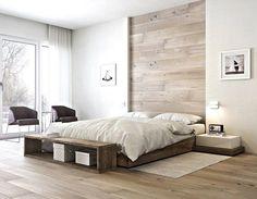 Weiße Wand und Holz im puristisch eingerichteten Schlafzimmer