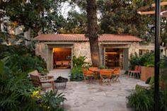 That rustic bungalow is designed by Marina Linhares Decoração de Interiores and located in Brazil. Did you spot that the exterior doors are symmetrical? The facade is marked by simple, warm stone in terracotta. Outdoor Spaces, Outdoor Living, Outdoor Decor, Boho Glam Home, Interior Tropical, Hacienda Style, Spanish Revival, Stone Houses, Exterior Doors