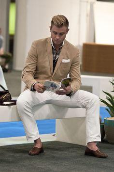 Men's fashion - white jeans, beige blazer, plaid button up.