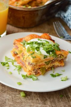 Enchilada Breakfast Casserole is great for feeding a crowd. Make it the night before and pop in the oven the next morning.