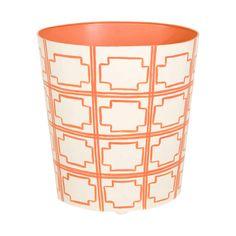 Oval wastebasket orange and cream.