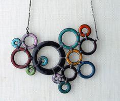 Google Image Result for http://www.wildthingsartisans.com/wp-content/uploads/2009/10/molecule-necklace-crop.jpg