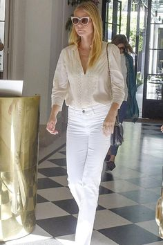Gwyneth Paltrow wearing Self-Portrait x Le Specs Luxe Edition One Sunglasses, Frame Le High Flare High-Rise Jeans and St. Roche Liz Blouse