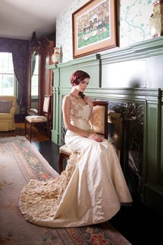 An open parlor and a champagne wedding dress.  Love the green fireplace!