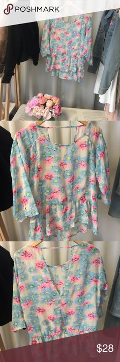 Floral Chiffon Ruffle Blouse Florals for spring? Heck yes! Cute peplum style ruffle detail along the bottom trim with a cute cut out in the back! Worn just a few times. Tops Blouses