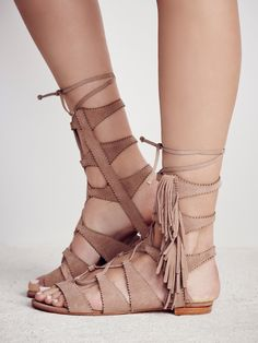 Sonya Fringe Lace Up Sandal | Brazilian suede lace-up gladiator sandals with fun statement fringe detailing down the sides and scalloped trim. Leather soles.