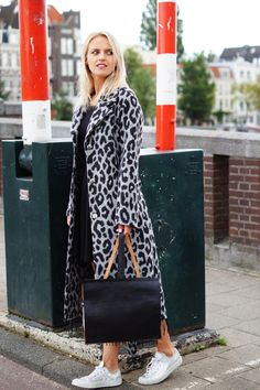 Staying cozy & comfy with this street style outfit now that Fall is here: big cardigan with animal print, leather backpack by Dutch Basics and sneakers! Read more on this fashion blog: http://bagatyou.com/dutch-basics/
