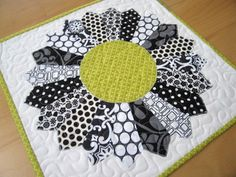 Check out this tutorial for a Chunky Dresden Plate quilt block that has only 12 blades and is really easy to do. A downloadable template is included.