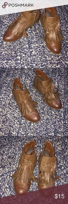 Ankle boots with tassels Cute brown boots with tassels and bow, faux leather. Very cute with jeans. Comfortable. Used condition but no scuffs or scratches. Shoes Ankle Boots & Booties