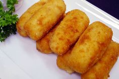 Croquetas de Jamon - Spanish Ham Croquettes.  Another favorite Tapa!  These taste really good with Spanish ham (jamón serrano) and chicken.  If you cannot find Spanish ham, prosciutto will do.  These are fantastic with jamón and manchego cheese too!