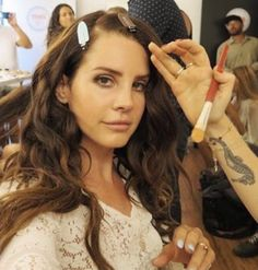 Lana Del Rey getting her makeup done by her makeup artists