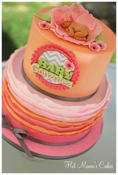 Pretty In Peach Baby Shower Pretty In Peach Baby Shower Peach ruffles with chevron print.. The baby topper was made using a mold and added the flower beanie as a cute... #coral #pink #wedding #cakecentral #Jackie