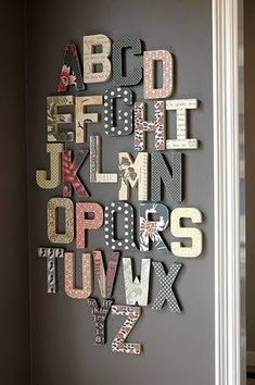 I love this idea for a nursery-- heard also that you can assign a letter of the alphabet to friends and family to decorate from all...