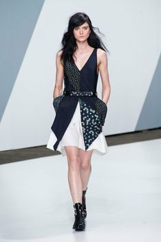 Spring 2013: Flirty dresses in navy and white floated down the runway.